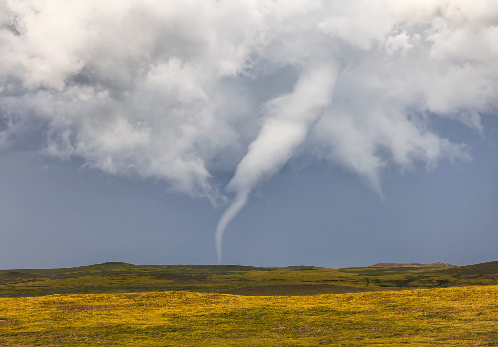 Stove pipe tornado starting to rope out. Captured near Ralph, South Dakota on June 21, 2015